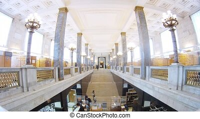 Readers go on lobby at cardfile of huge library, time lapse