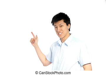 Asian man pointing to blank copyspace - Smiling young Asian...