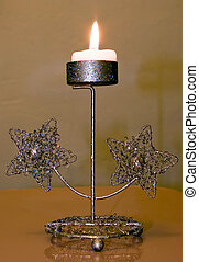 Candle - The festive candle stands on a table