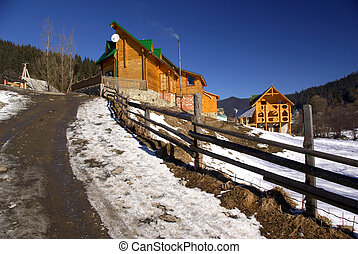 Settlement - Small wooden houses in a hilly terrain