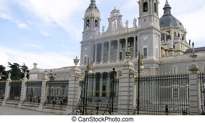 Tourists go sightseeing in Almudena Cathedral, time lapse