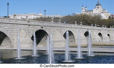 Bridge Puente de Segovia stands against Cathedral, time...