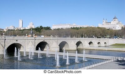 Bridge Puente de Segovia stands against Almudena Cathedral