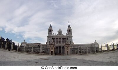 Almudena Cathedral stands in center against clouds, time...