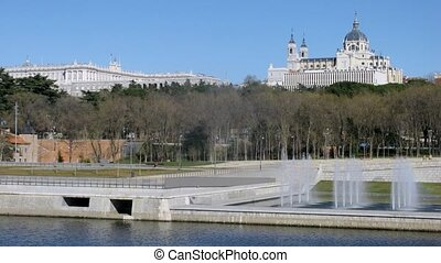 Almudena Cathedral stands near river and fountain, time...