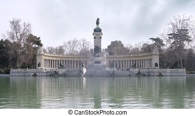 Monument to King Alphonso stands in park Buen Retiro, time...
