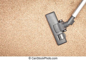 Vacuum cleaner - Head of a modern vacuum cleaner on a beige...