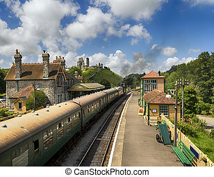 Steam Trains at Corfe Castle Station - A steam train pulls...