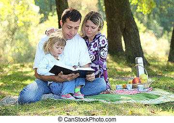 family read the Bible in nature - young family read the...