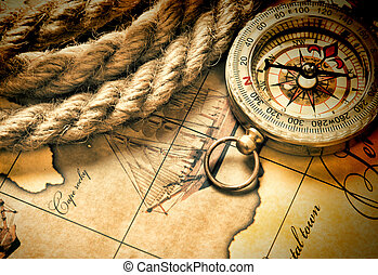 compass and rope on map - compass and rope on a map
