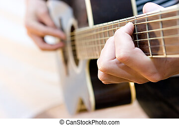 Guitarist - Young artist playing guitar on white background