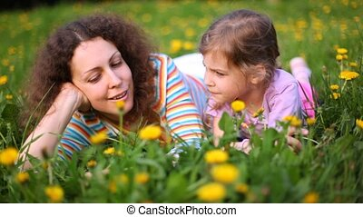 Mother and daughter talk in sunny weather - Mother and...