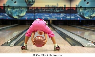 Little girl throws bowling ball, then jumps and walks away -...