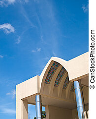 Pointed arch entrance hall of office building on blue sky