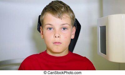 Face of boy which moves in medical diagnostic apparatus -...