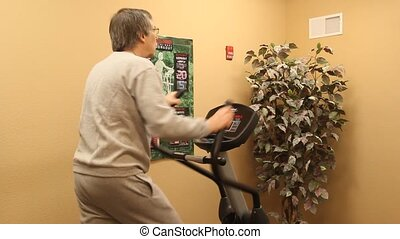working out - man working out on exercise machine