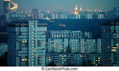 Panorama of evening cityscape with illumination, shown in...
