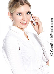Smiling businesswoman calling using her cellular phone