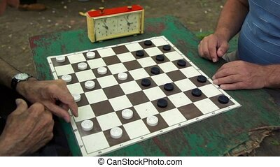 People play checkers with time limit, and then girl cames