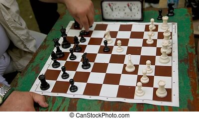 People play chess with time limit, closeup view of table
