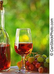 Glass and grapes of rose  wine.