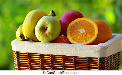 Basket of colored fruits.