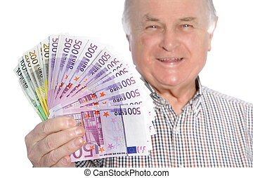 Smiling senior man with a fistful of money - Smiling senior...