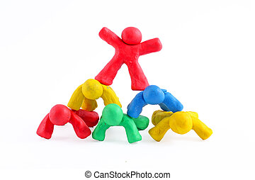 six colorful plasticine guys making a human pyramid