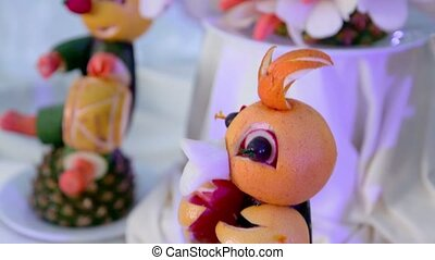 Table adornment fruit statuette, closeup view in motion