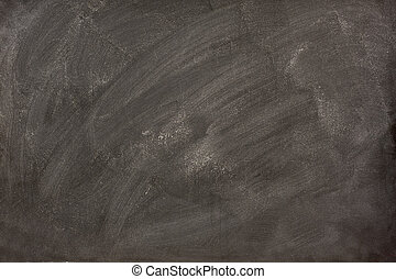 white chalk smudges on a blackboard - white chalk dust and...
