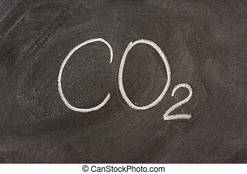 chemical symbol for carbon dioxide on a blackboard -...