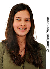 Beauty in Braces - Portrait of a smiling preteen gilr with a...