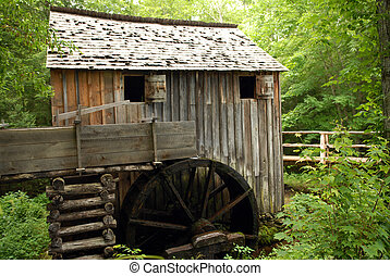 Old Water Mill - A weathered water whee and milll set in a...