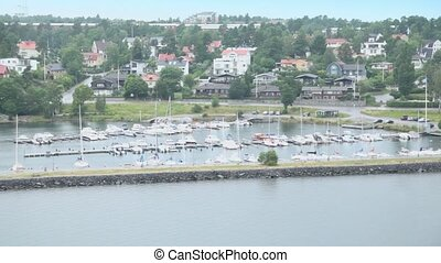 Many boats on moorage at coastal village near Stockholm -...