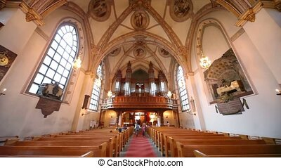 Tourists walk inside Klara kyrka church in Stockholm