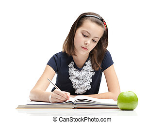 Doing homework - Young schoolgirl is doing her homework,...
