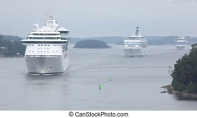 Three cruisers float between coastline near Stockholm