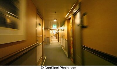 Motion through corridor with doors and lanterns on wall at...