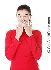 Shocked woman covering her mouth with hands, isolated on...