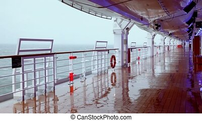 Empty deck with wooden floor of ship which float on sea at...