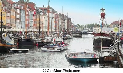 Excursion motorboats at Nyhavn canal in Copenhagen, Denmark