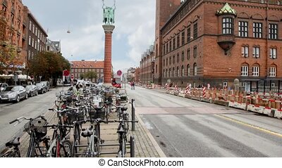 panorama carriageway of city with parking of bicycles