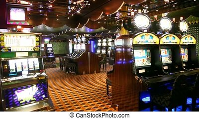game hall of empty casino with working slot machines