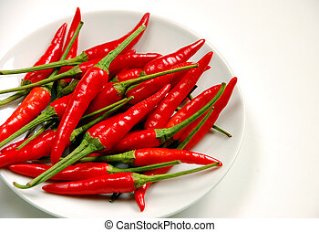 Red chilis on white plate