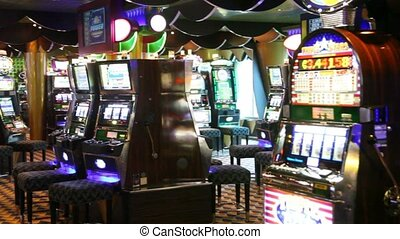 game hall of empty casino with switched-on playing machine