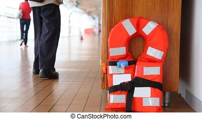 red life jacket on ship deck close up and man, opening case