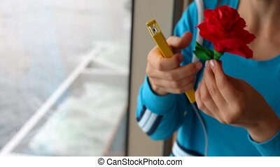 female hand doing flower from color paper near ship window -...