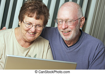 Senior Adults on Laptop Computer - Senior Adults on Working...