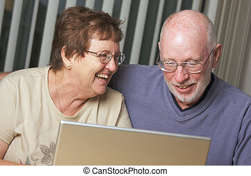 Senior Adults on Laptop Computer