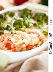 broccoli baked with mozzarella cheese, closeup food
